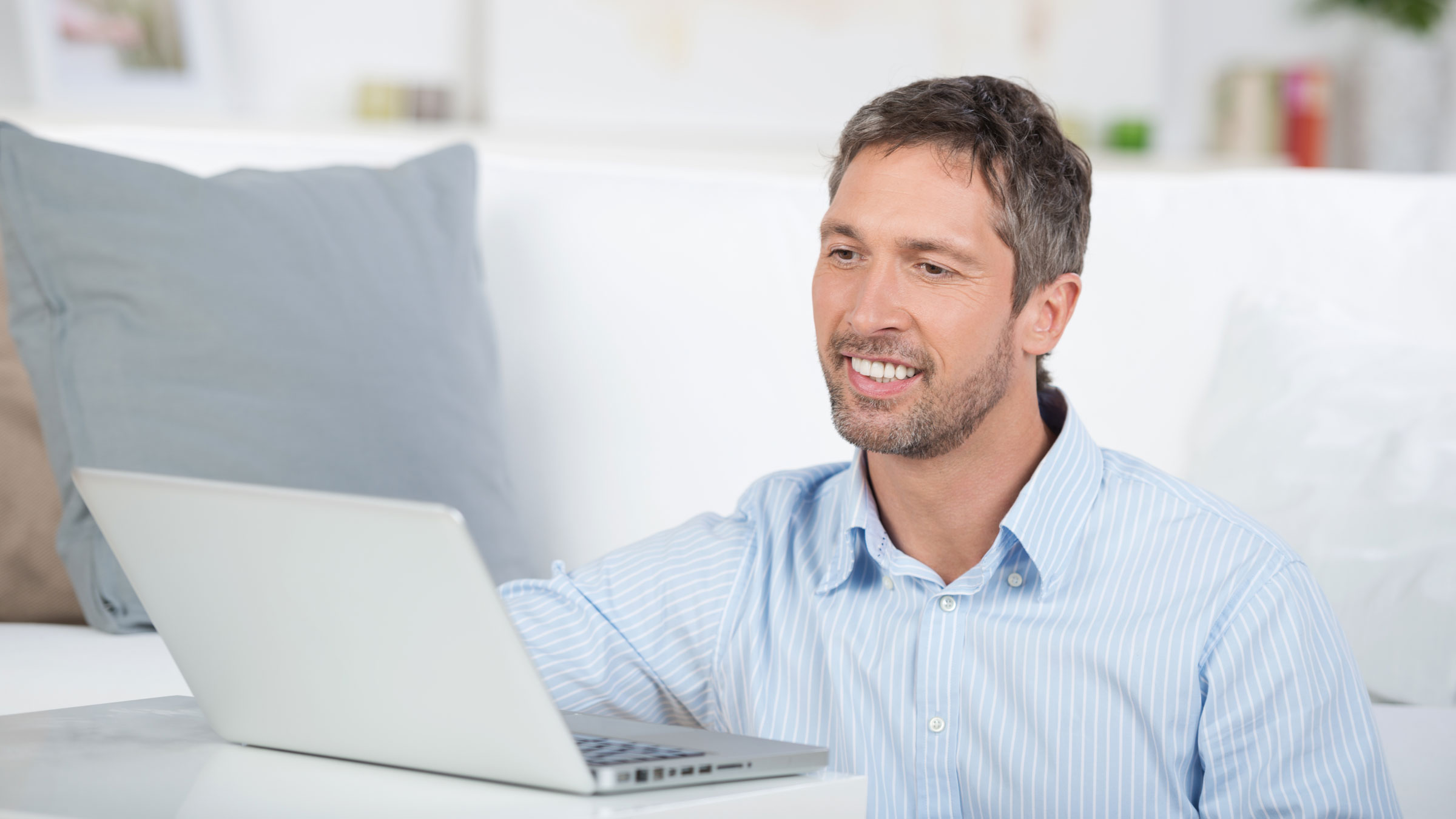 Man sitting in front of laptop