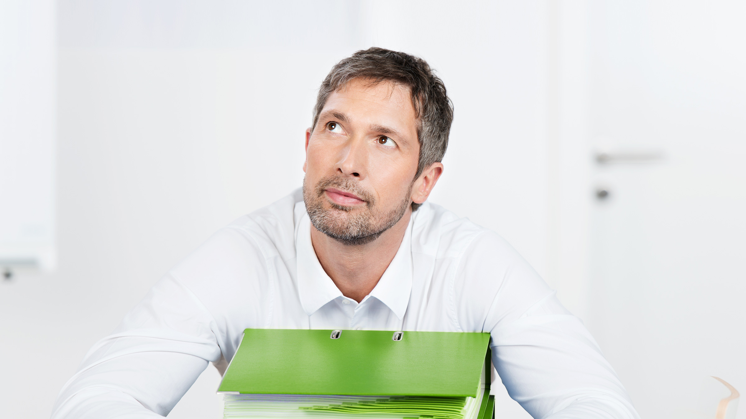 Man waiting with files